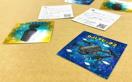 展示会で配布するビックリマン風ホログラムシール